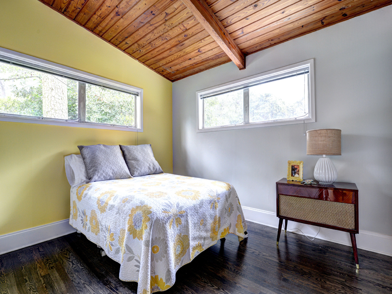 grey bedroom with yellow accent wall www